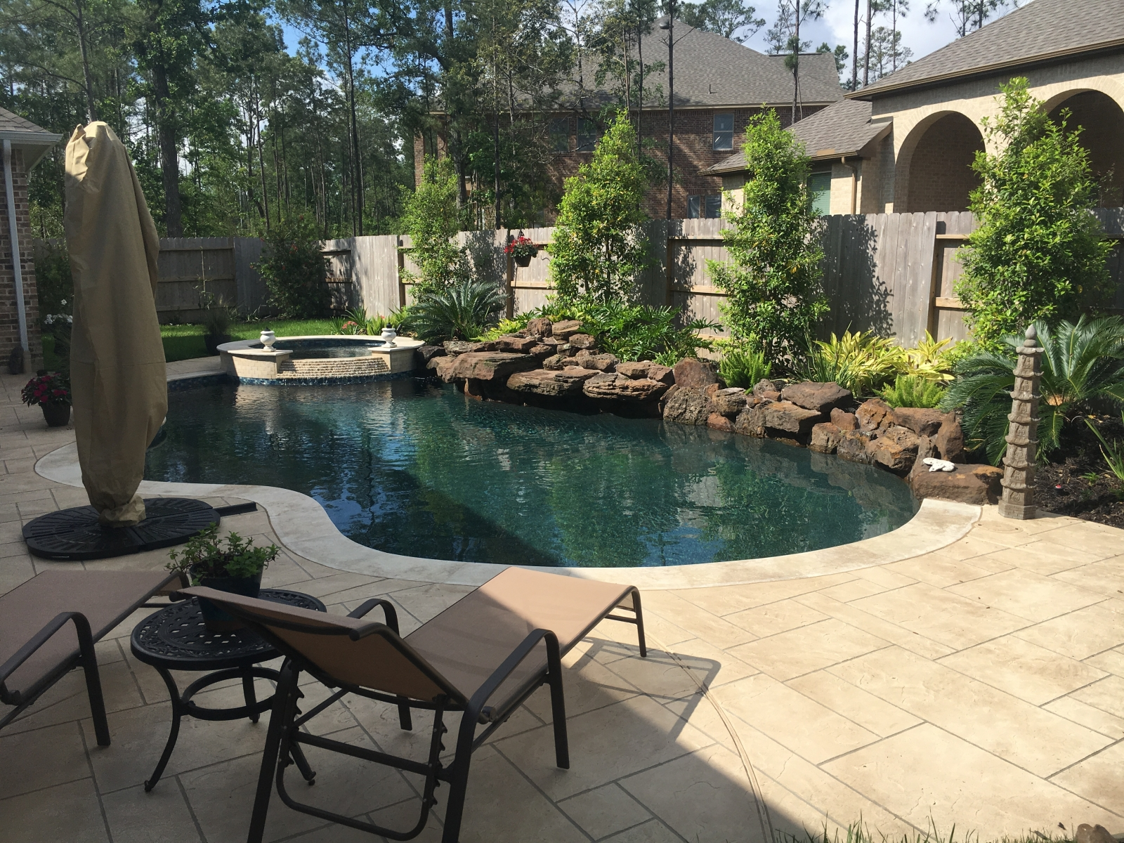 Freeform Pool with Pattern Overlay Decking