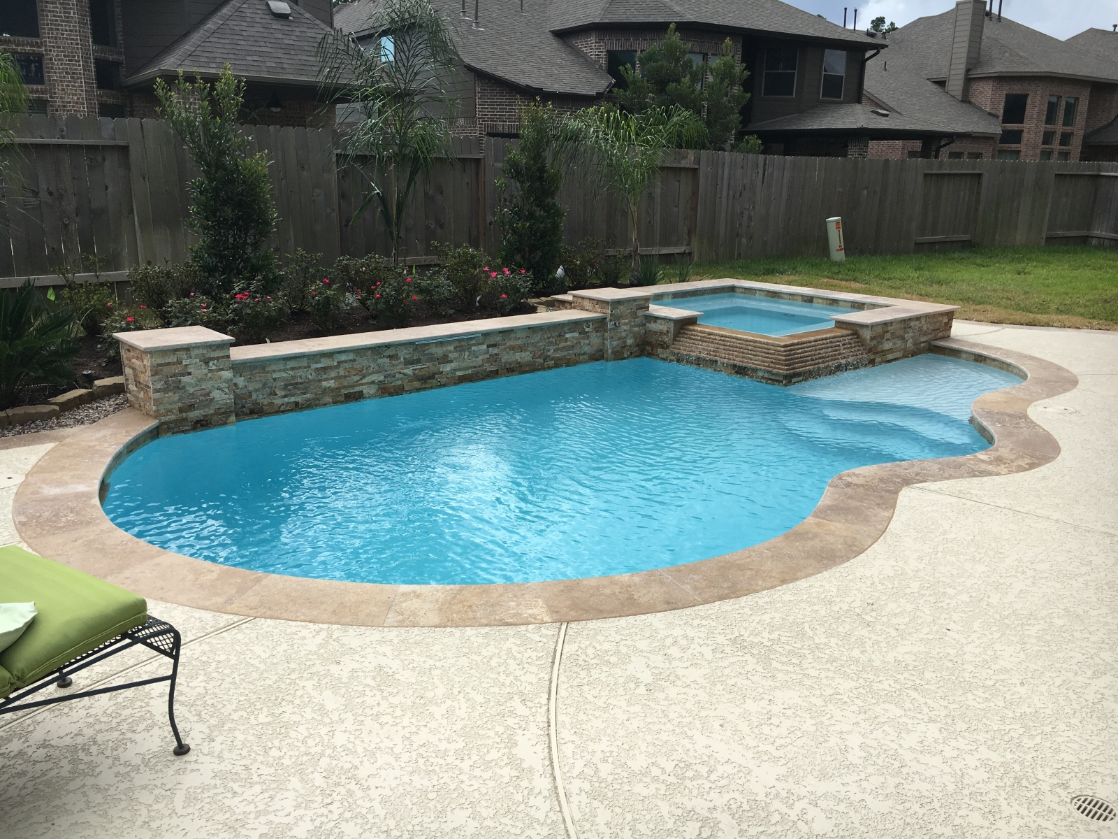 Freeform Pool with Square Raised Spa