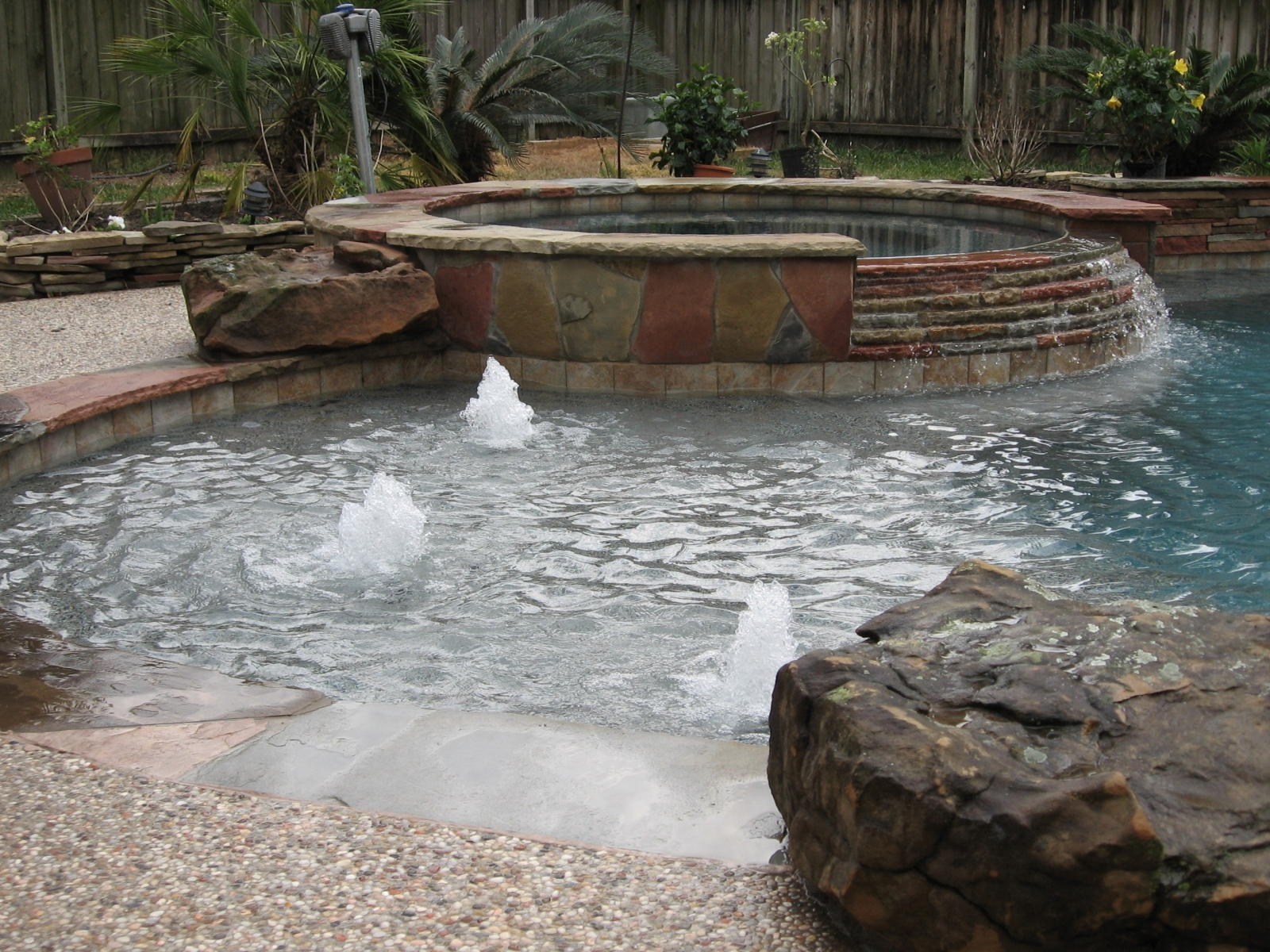 Freeform Pool with Flagstone, Tanning Ledge & Raised Spa