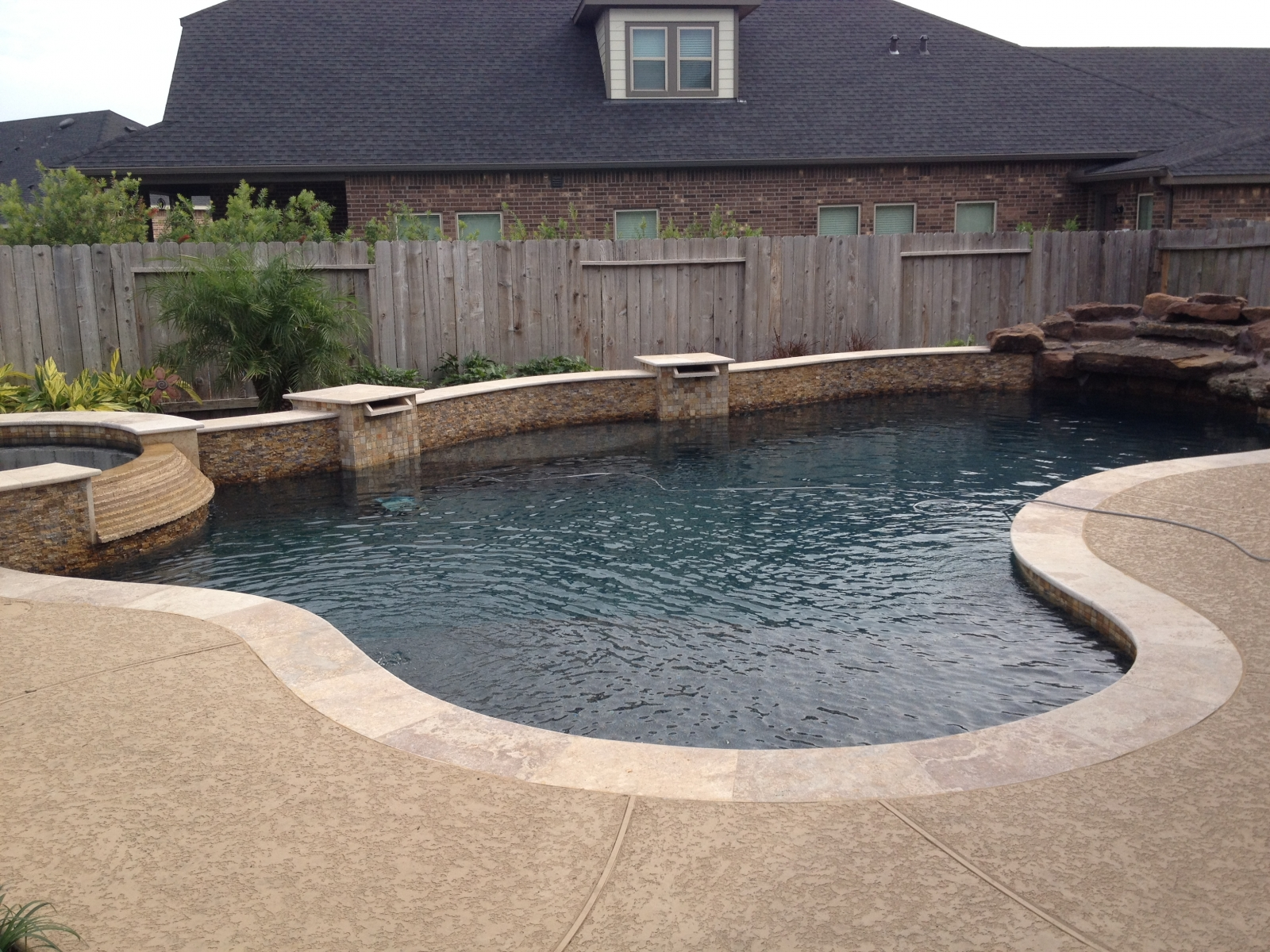 Freeform Pool with Spa, Scuppers, and Rock Grotto Waterfall