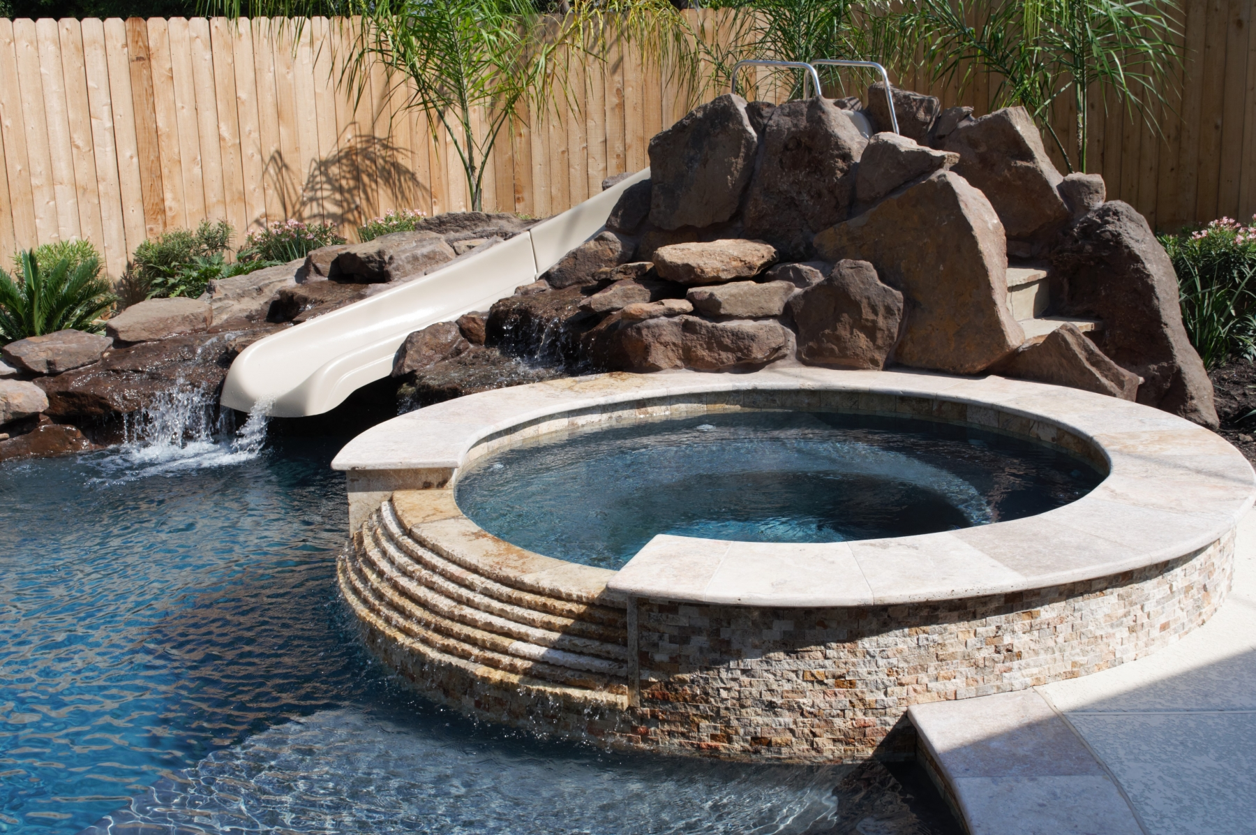 Freeform Pool with Rock Waterfall, Slide and Raised Spa