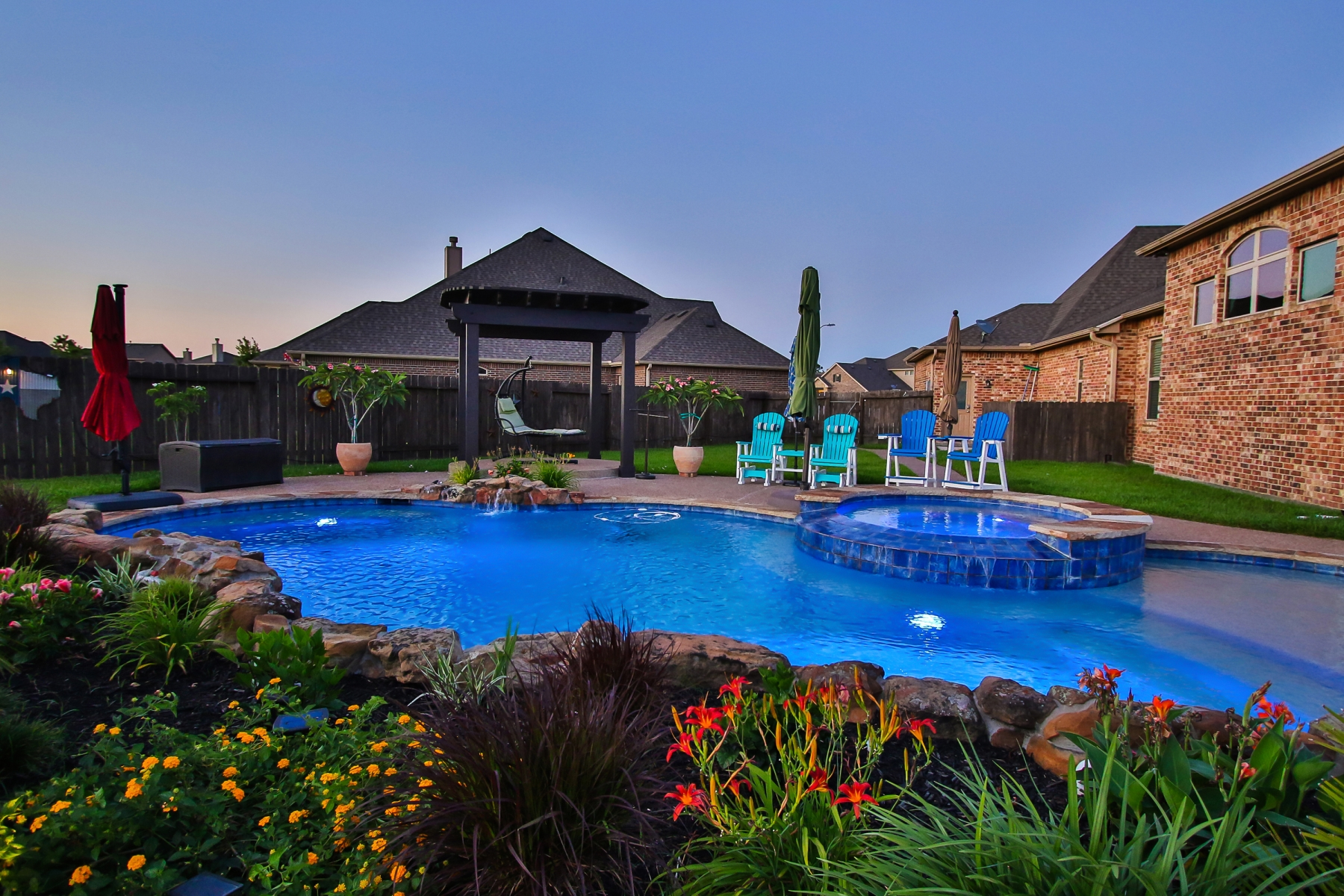 Freeform Pool with Custom Lighting, Tanning Ledge & Raised Spa