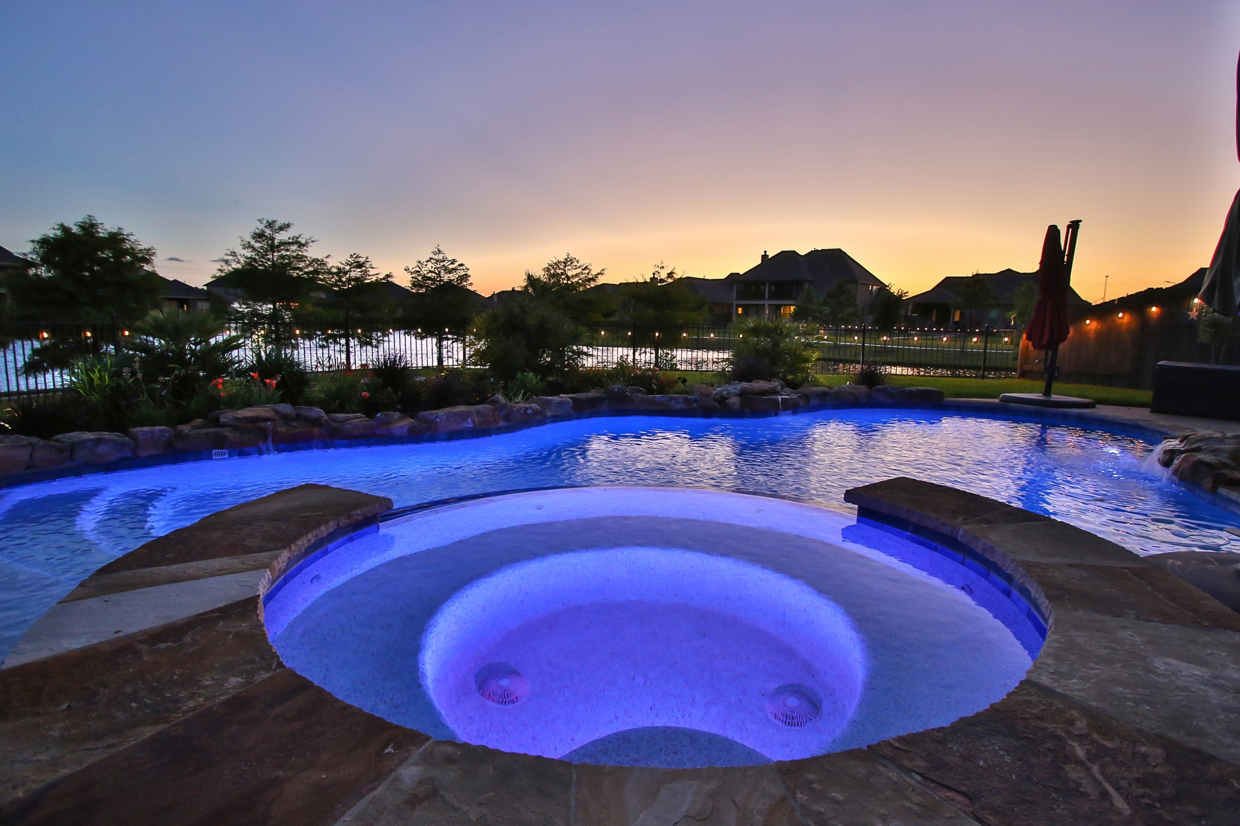 Spa View at Night - Freeform Pool with Custom Lighting