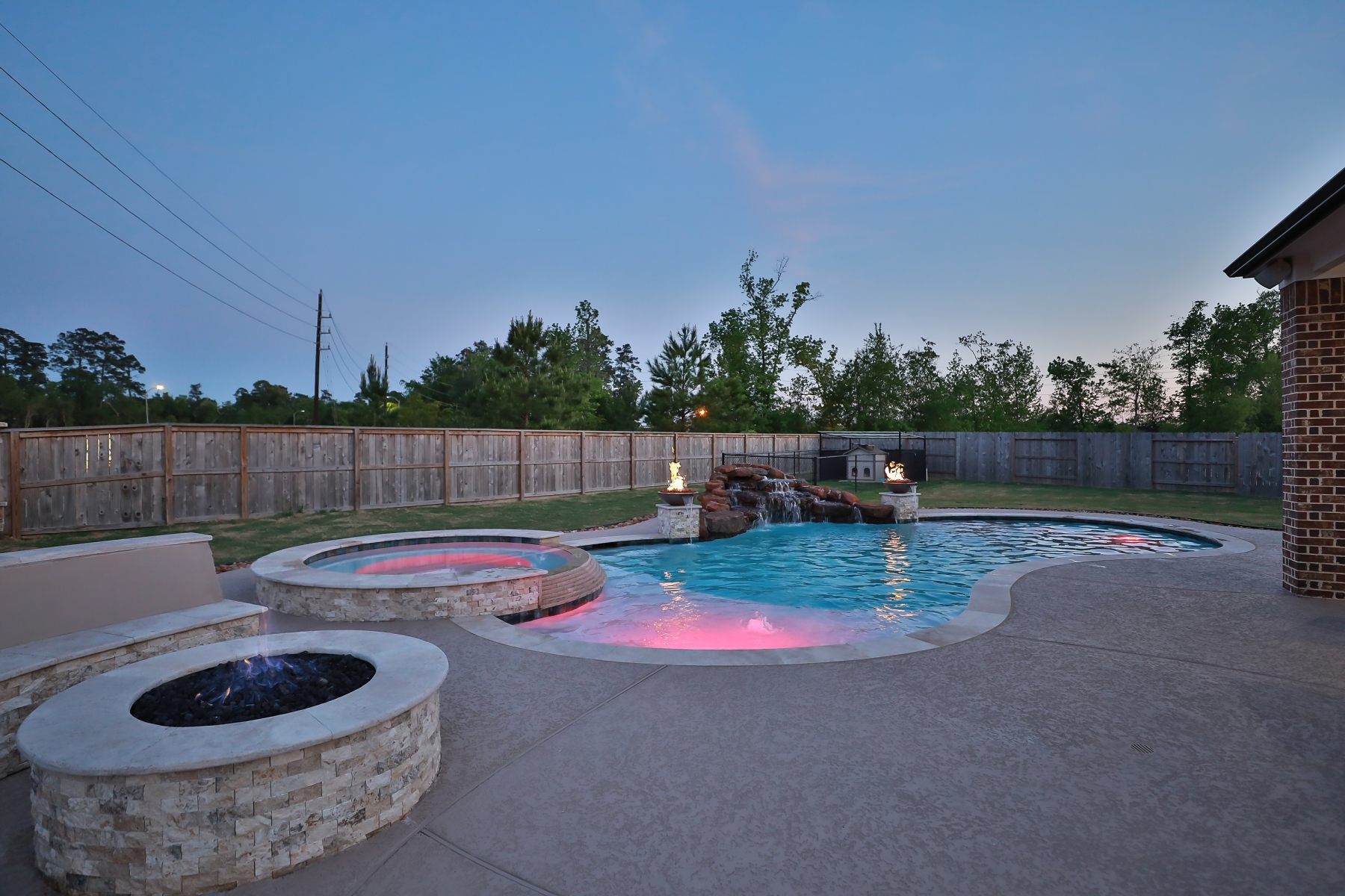 Freeform Pool with Rock Waterfall, Custom Lighting, Fire Bowls & Fire Pit Seating Area