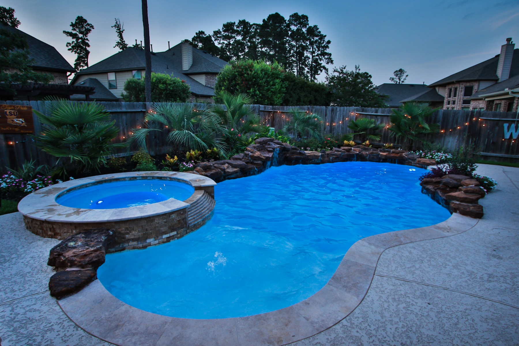 Freeform Pool with Rock Waterfall, Custom Lighting and Spa