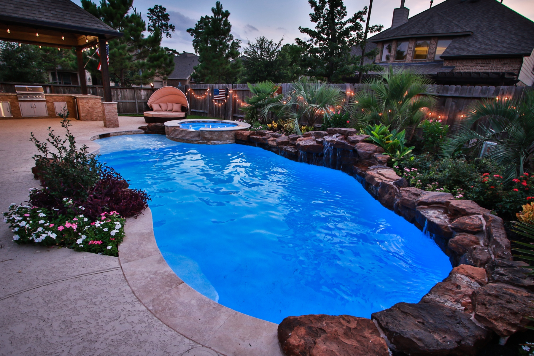 Freeform Pool with Rock Waterfall, Custom Lighting & Spa