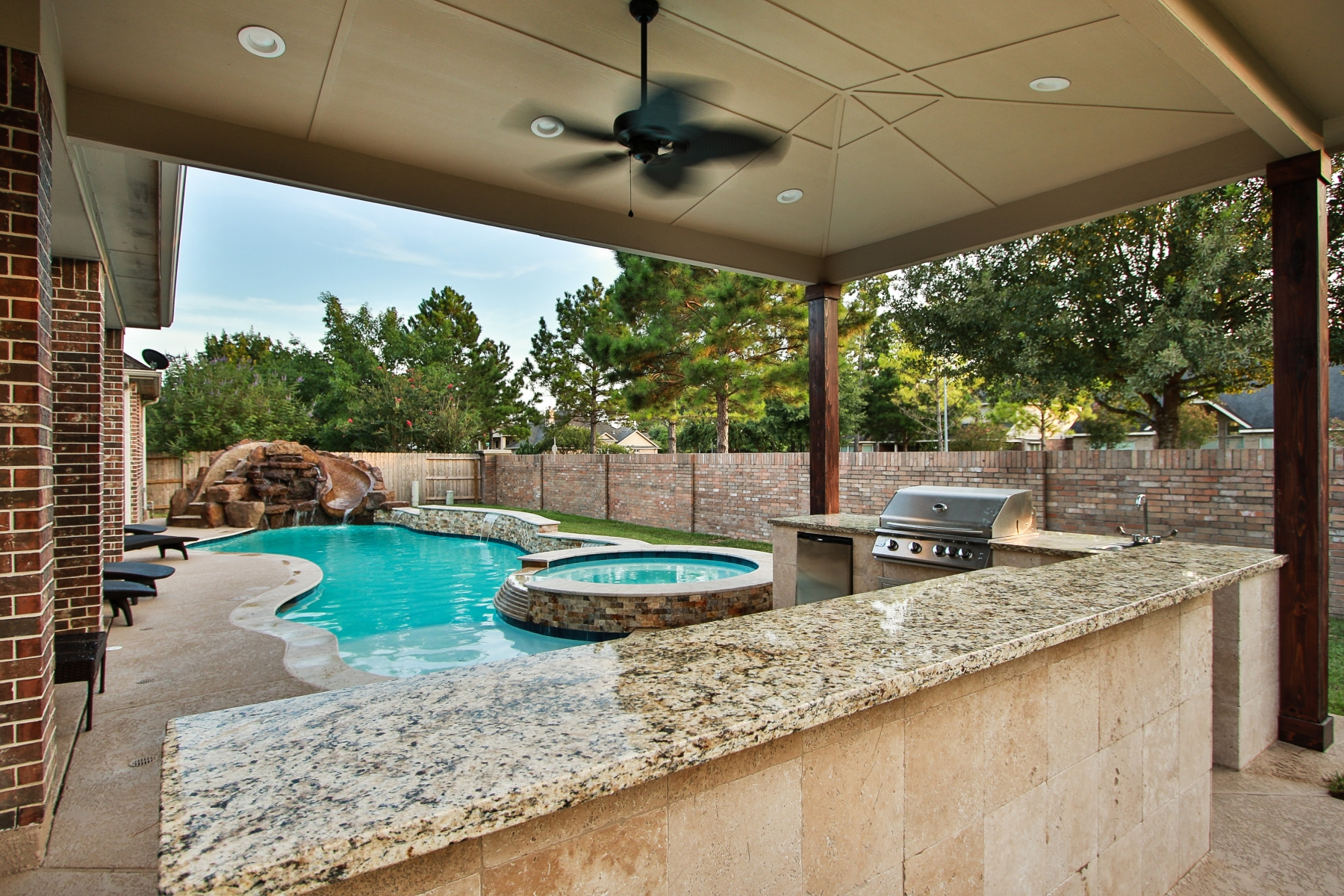 Freeform Pool Viewed From Outdoor Kitchen
