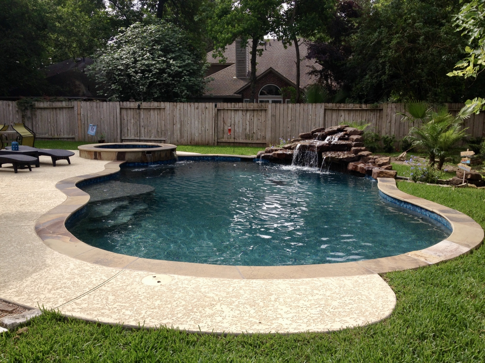Freeform Pool with Raised Spa & Rock Grotto Waterfall