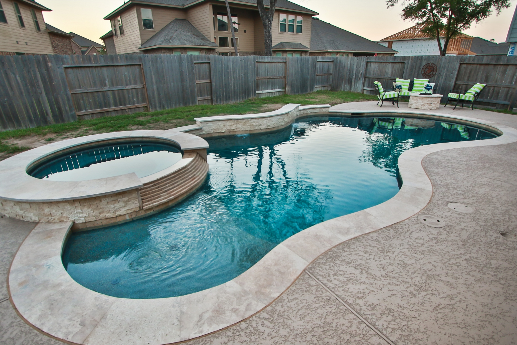 Freeform Pool with Tanning Ledge and Poolside Fire Pit and Seating Area