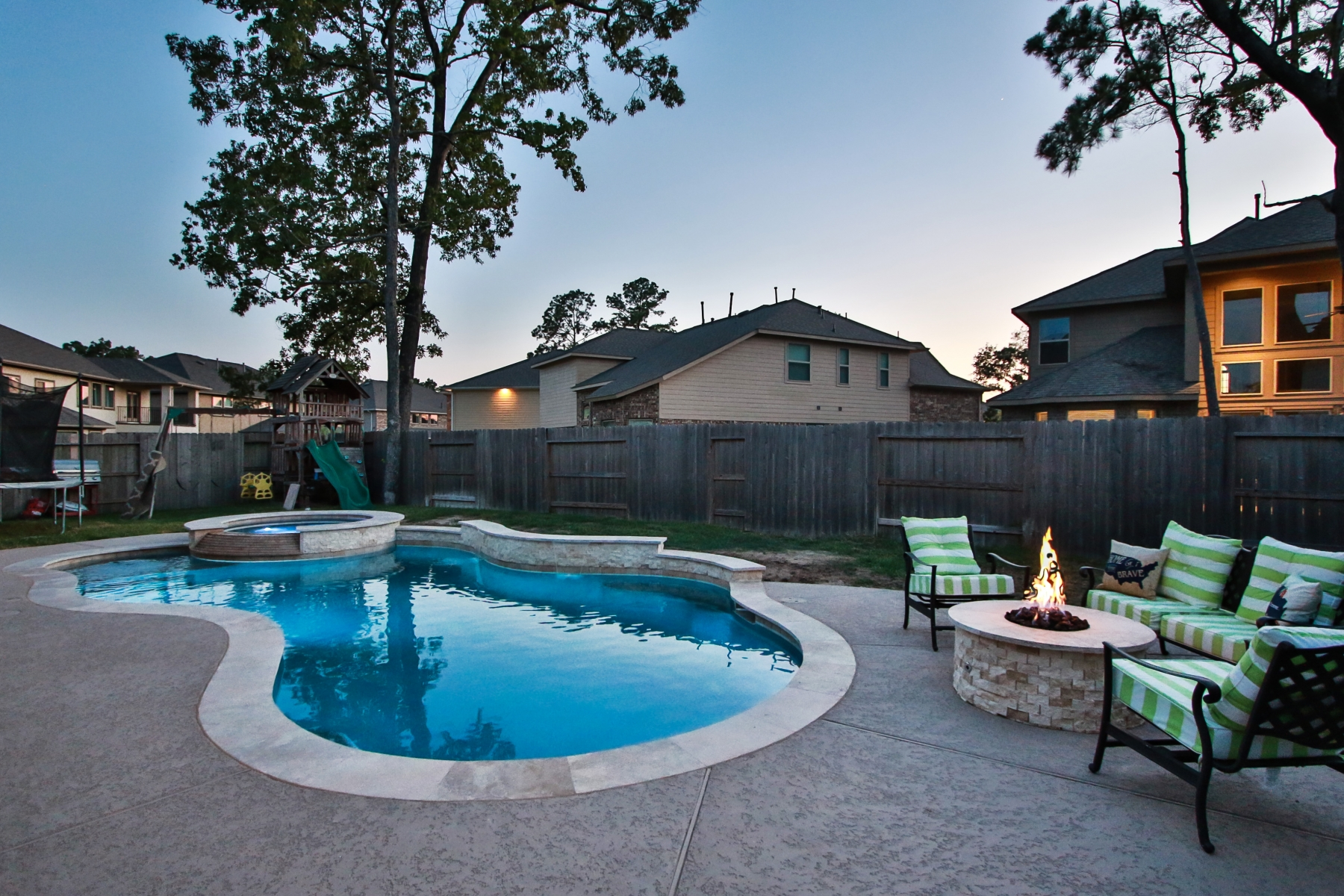 Freeform Pool and Fire Pit at Night