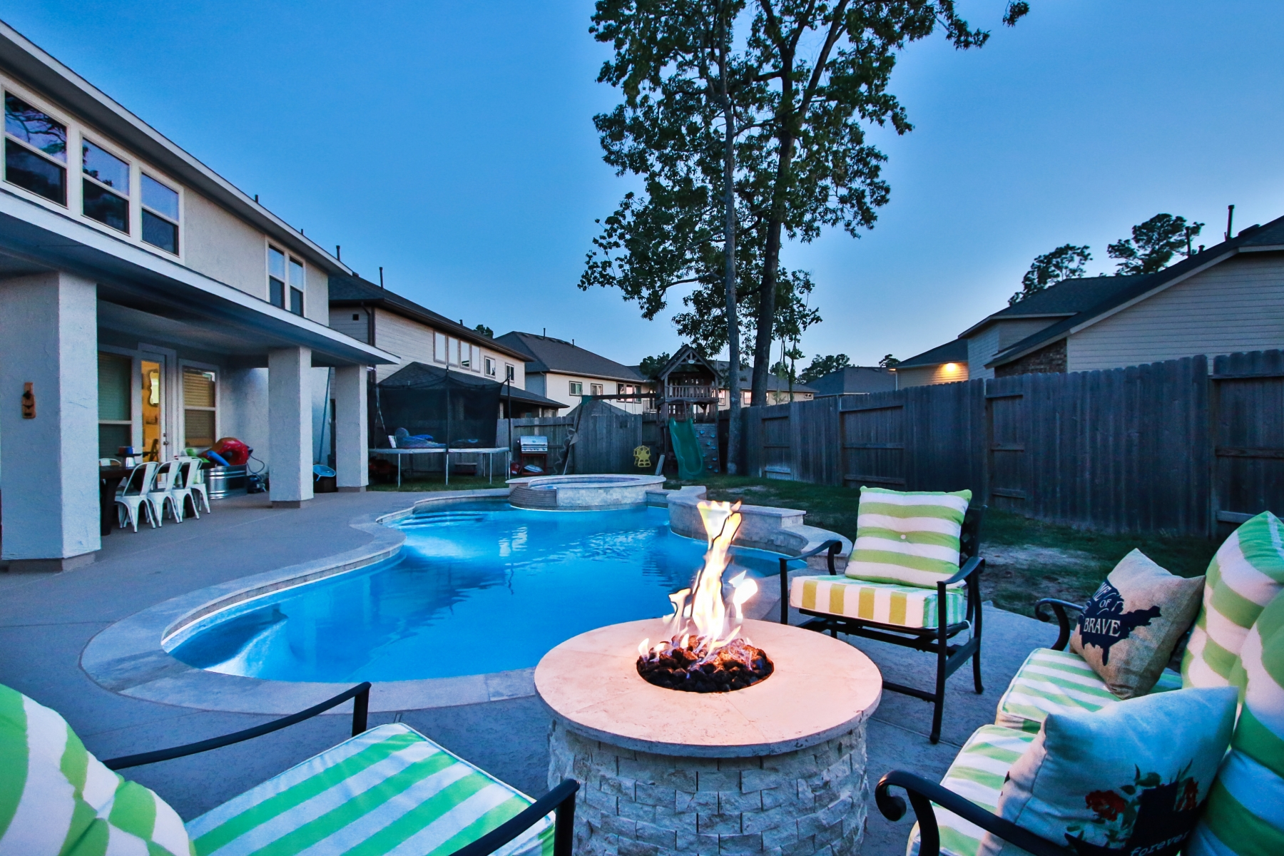 Fire Pit Seating Area Overlooking Freeform Pool at Night