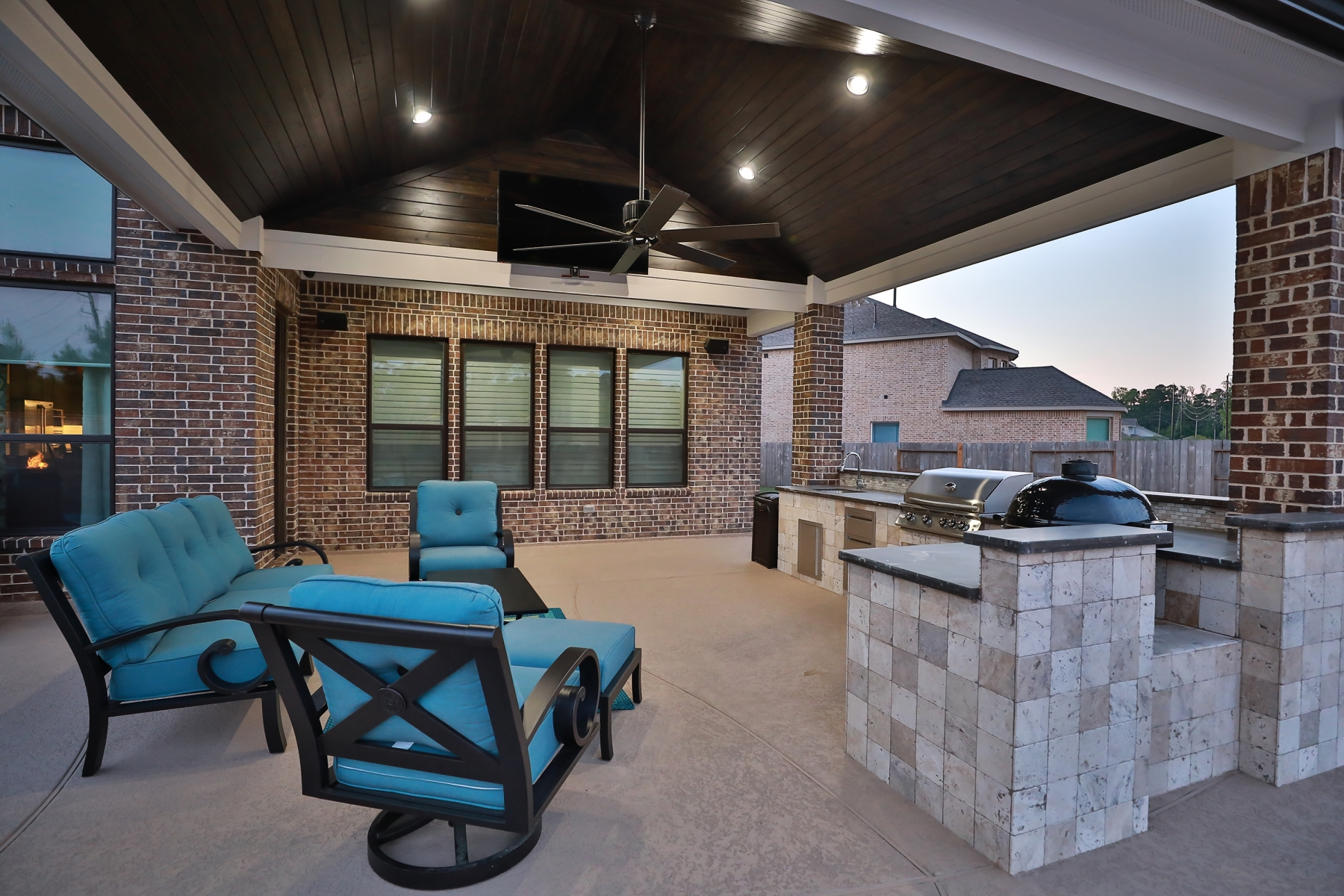 Covered Patio with Outdoor Kitchen and Seating Area
