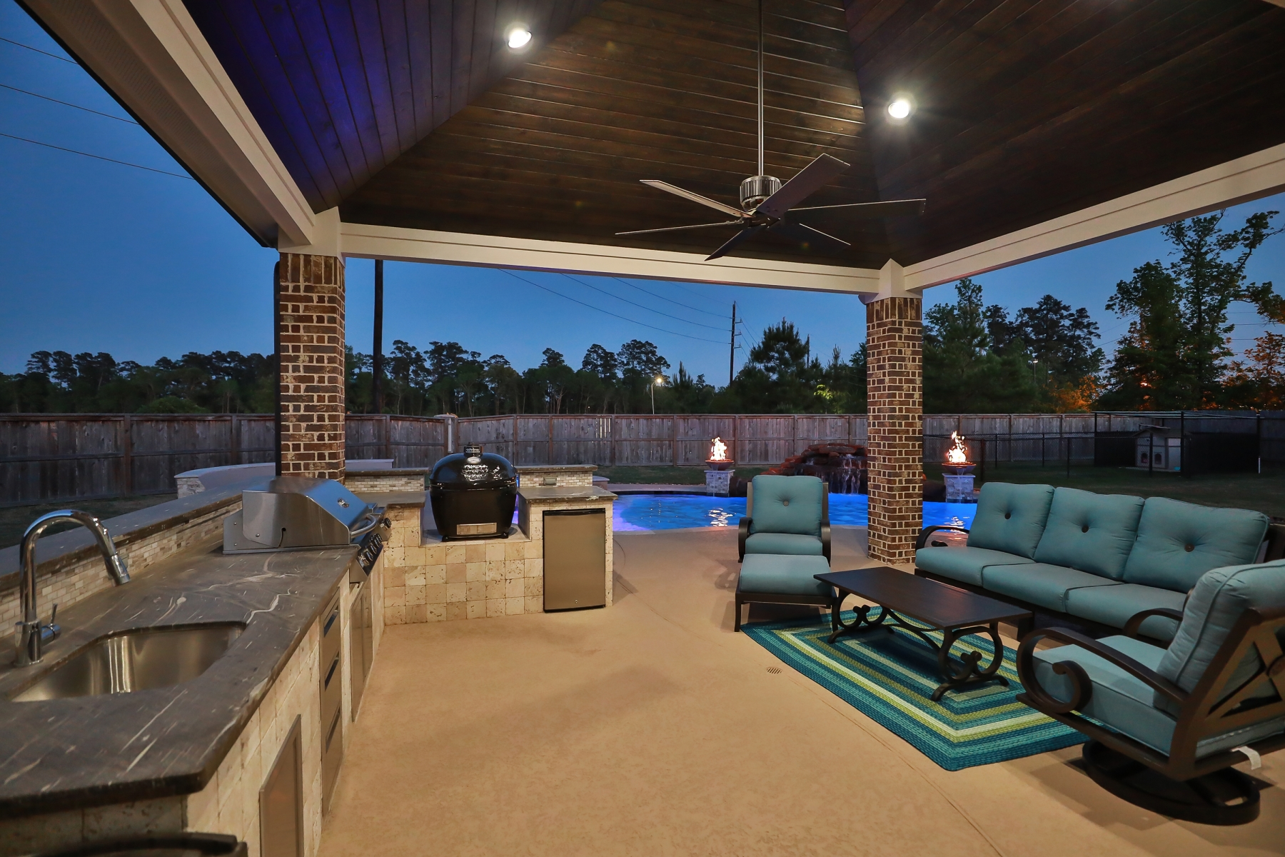 Outdoor Kitchen & Living Area Overlooking Pool at Night